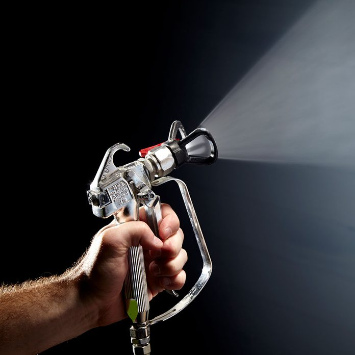 spraying paint out of an exterior spray painter   Construction Pro Tips