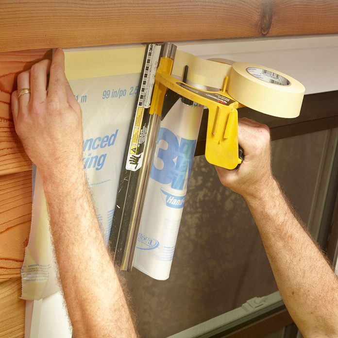 Taping off the frame of a window   Construction Pro Tips