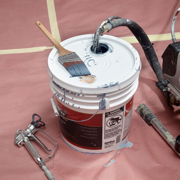 getting paint from a bucket into a spray painter   Construction Pro Tips