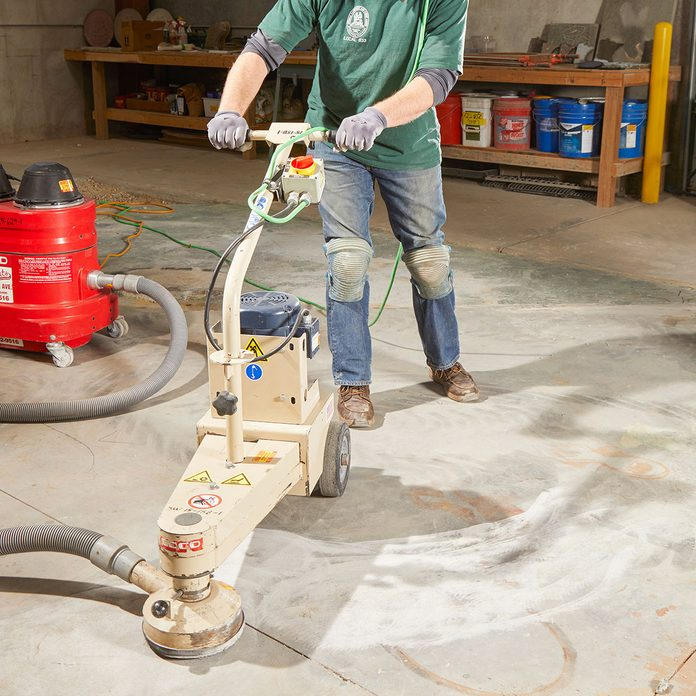 Operating a grinder on an uneven concrete slab   Construction Pro Tips