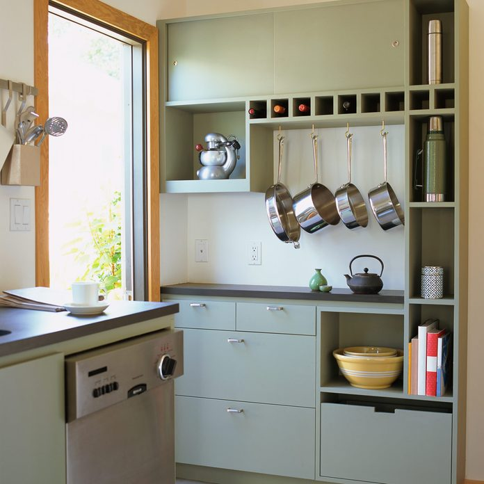 Contemporary kitchen hanging pots and pans Gettyimages 92571115