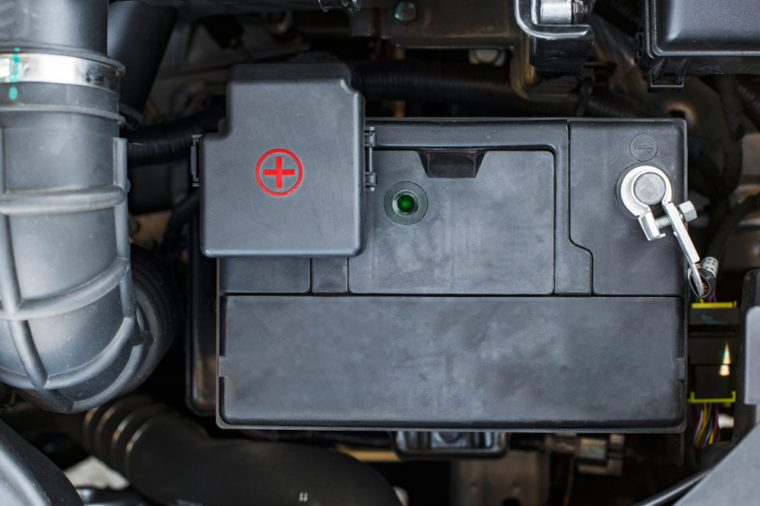 car battery and wires connected to it at shallow depth of field