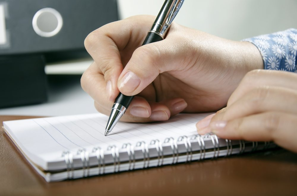 Young adult writing personal diary