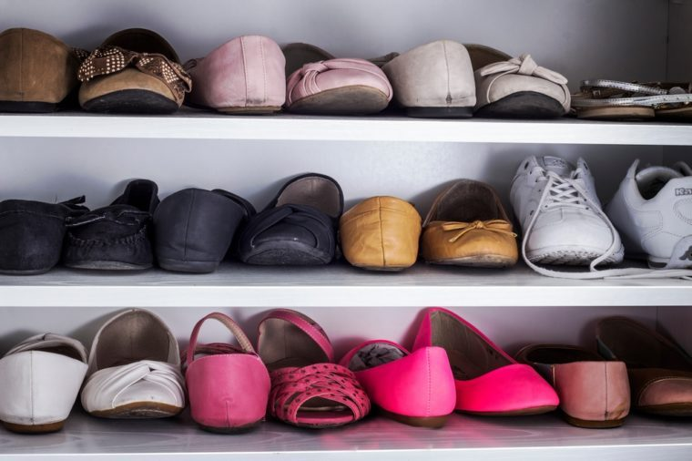 Background with shoes on shelves in a closet