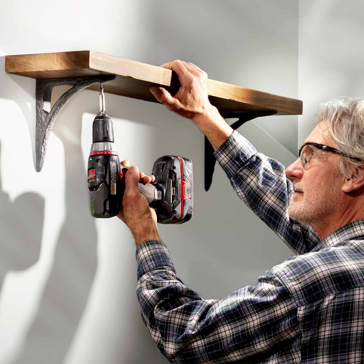 How to hang shelves on concrete walls without drilling