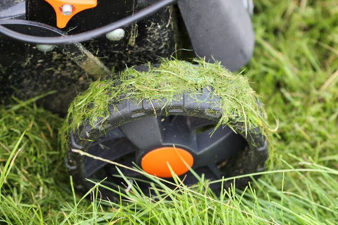 wet grass stuck to lawn mower tires
