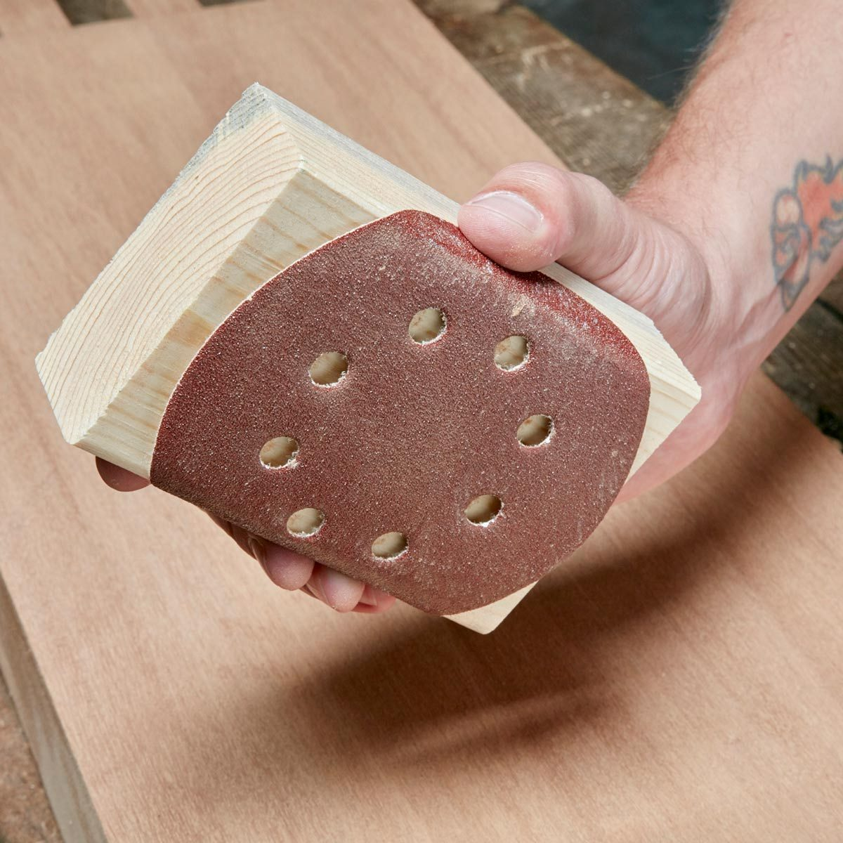Sandpaper-disc-wrapped-around-wood-block