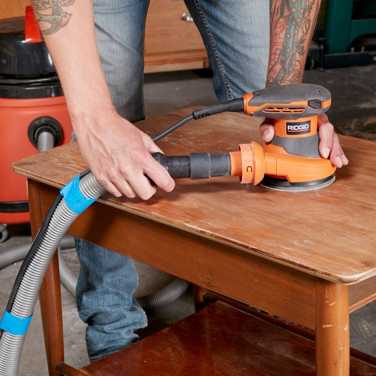 Shop-vacuum-hooked-up-to-random-orbit-sander