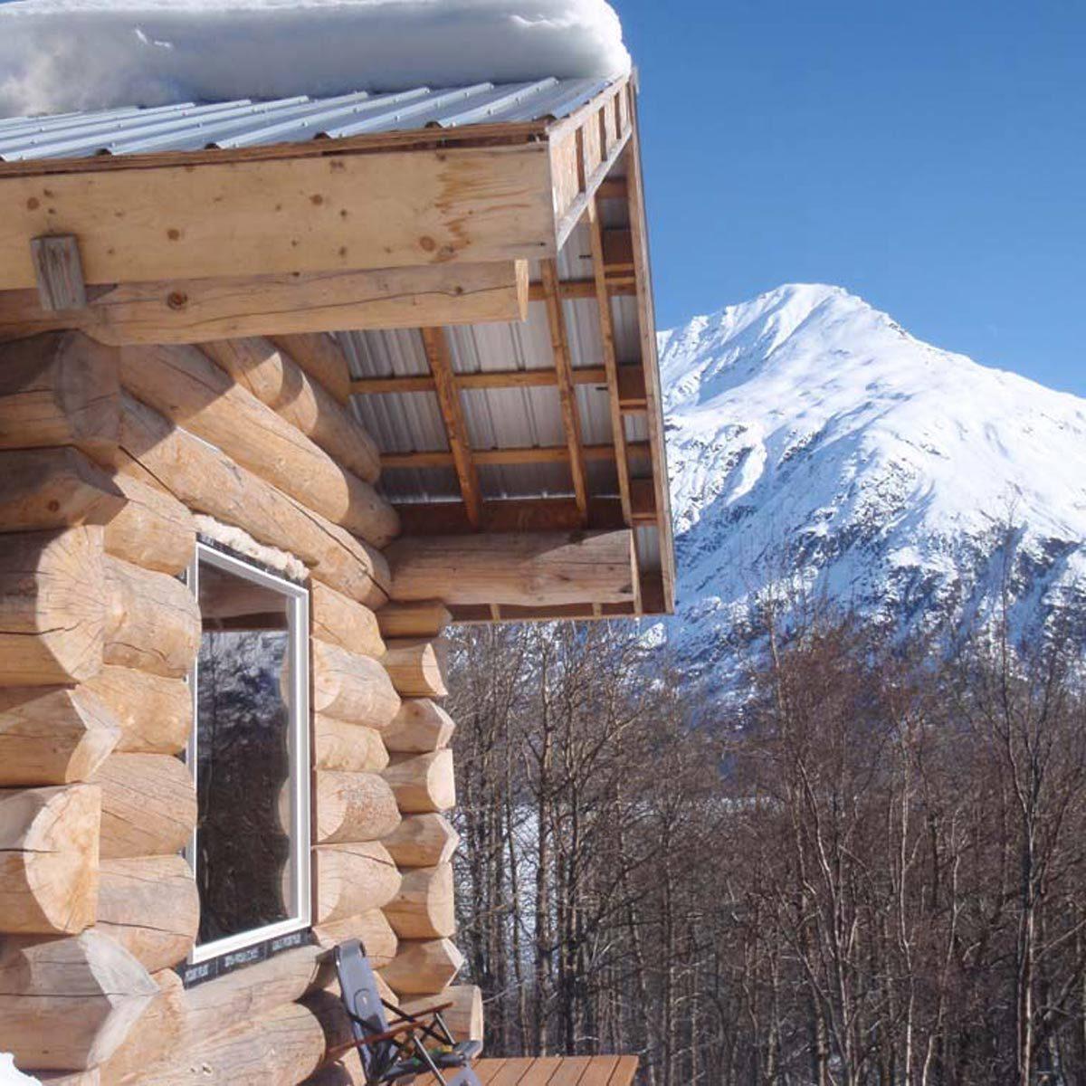 custom log cabin overlooking Alaskan mountains
