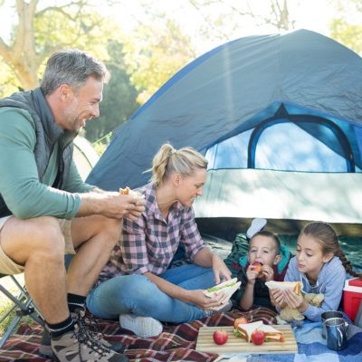 Family having snacks outside the tent at campsite; Shutterstock ID 633936041; Job (TFH, TOH, RD, BNB, CWM, CM): TOH