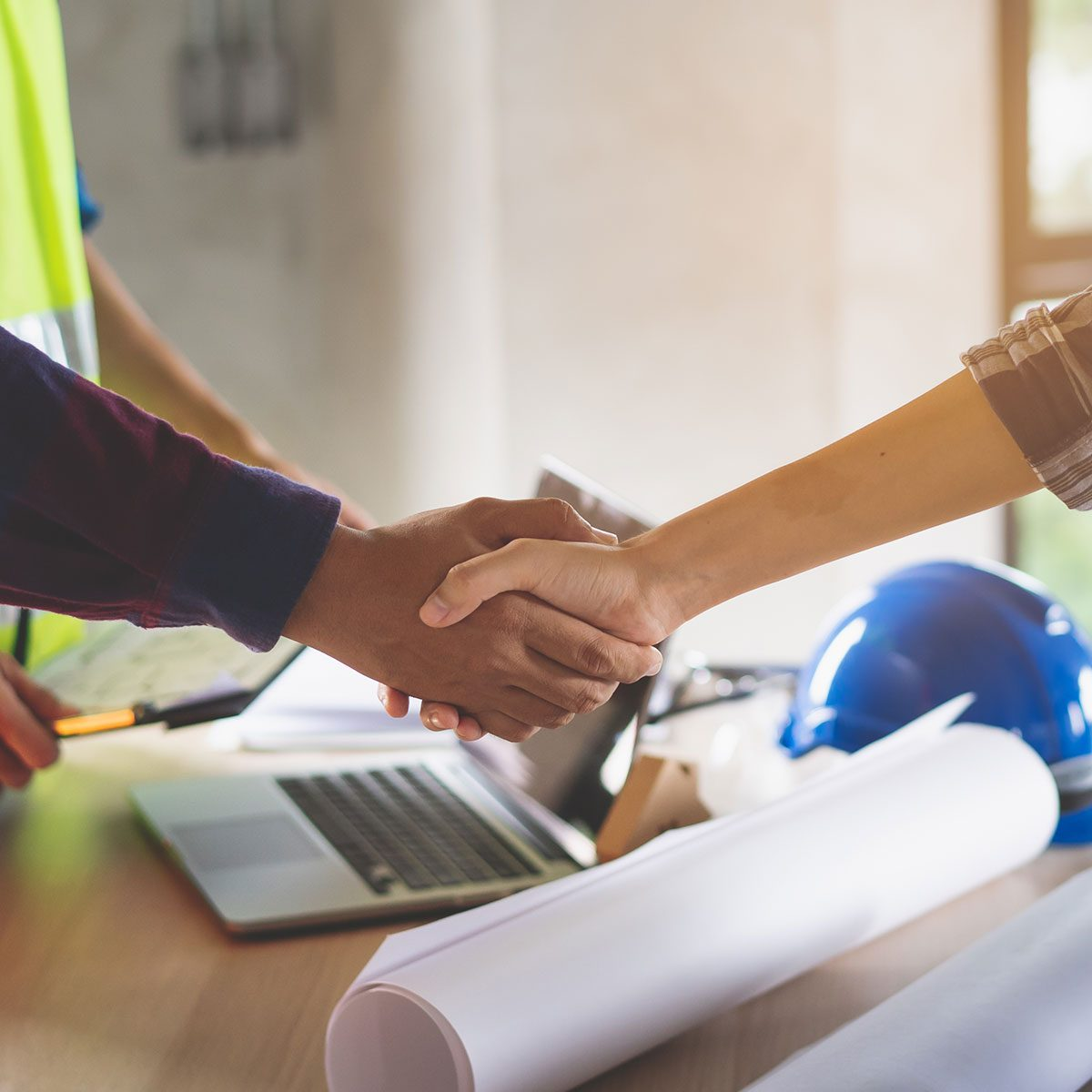 Shaking hands over a construction deal