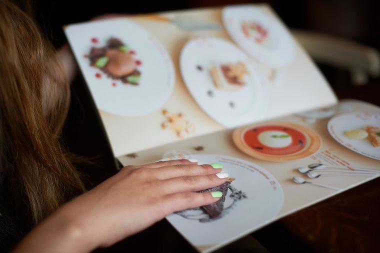 Menu card in woman's hand