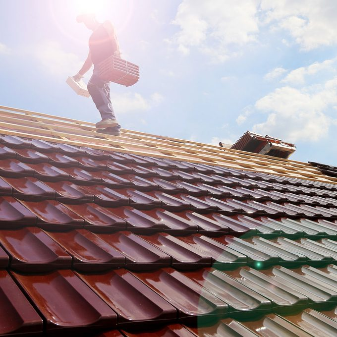 laying special tile shingles on a roof | Construction Pro Tips