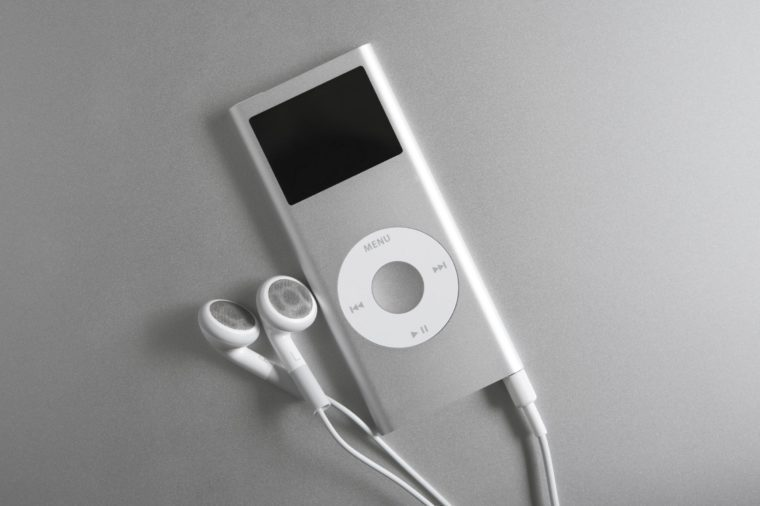 mp3 player and earbuds on silver surface
