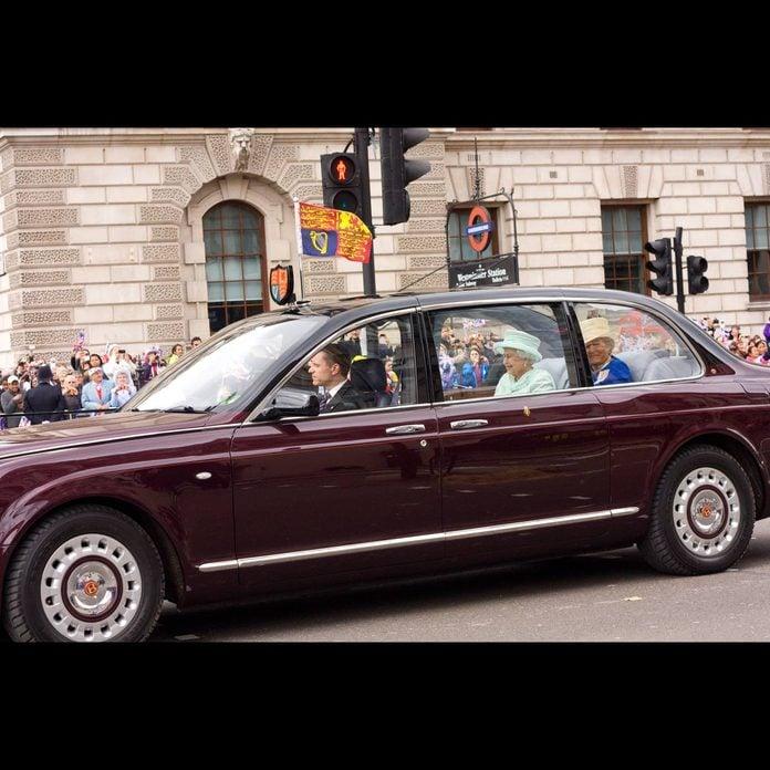 Queen Elizabeth rides in a Bentley
