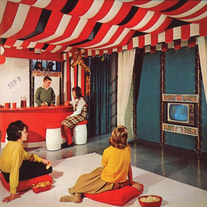Children watch television in a circus themed room in the 1960s