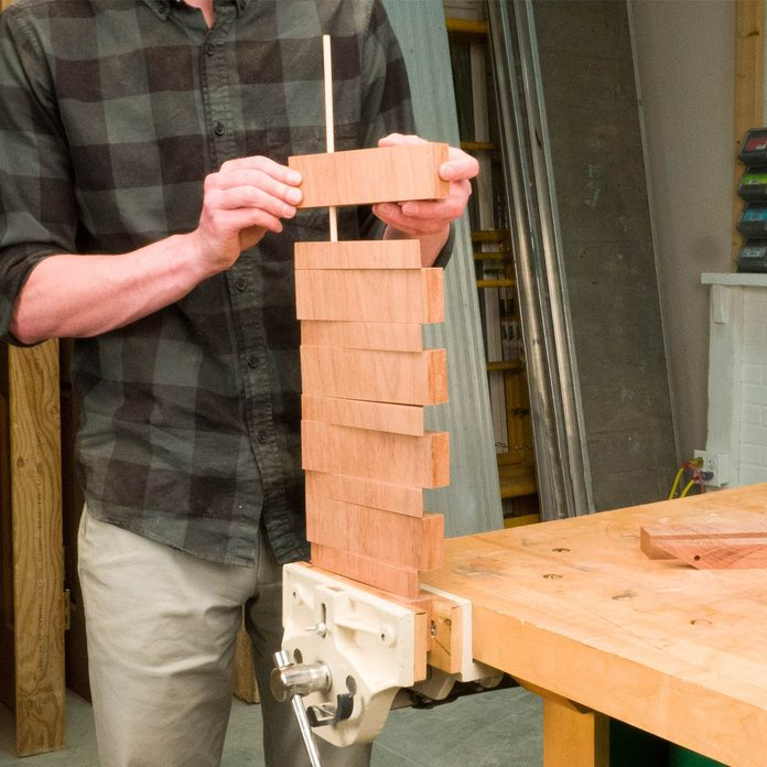 pivoting coat rack sand and assemble the rack