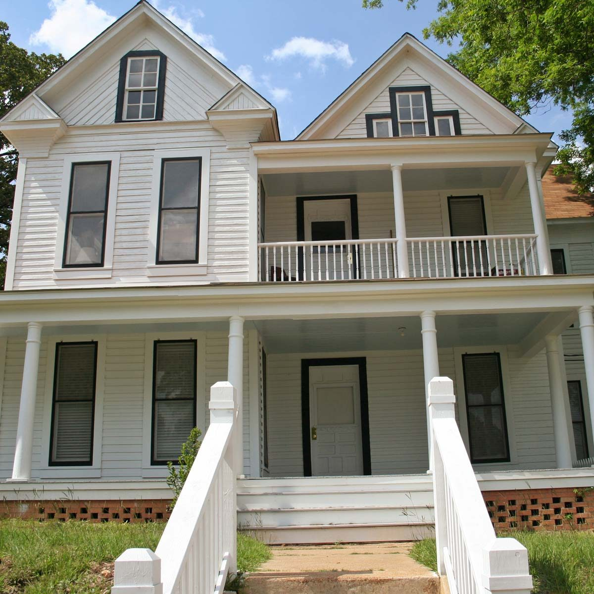white colored historic farmhouse style home