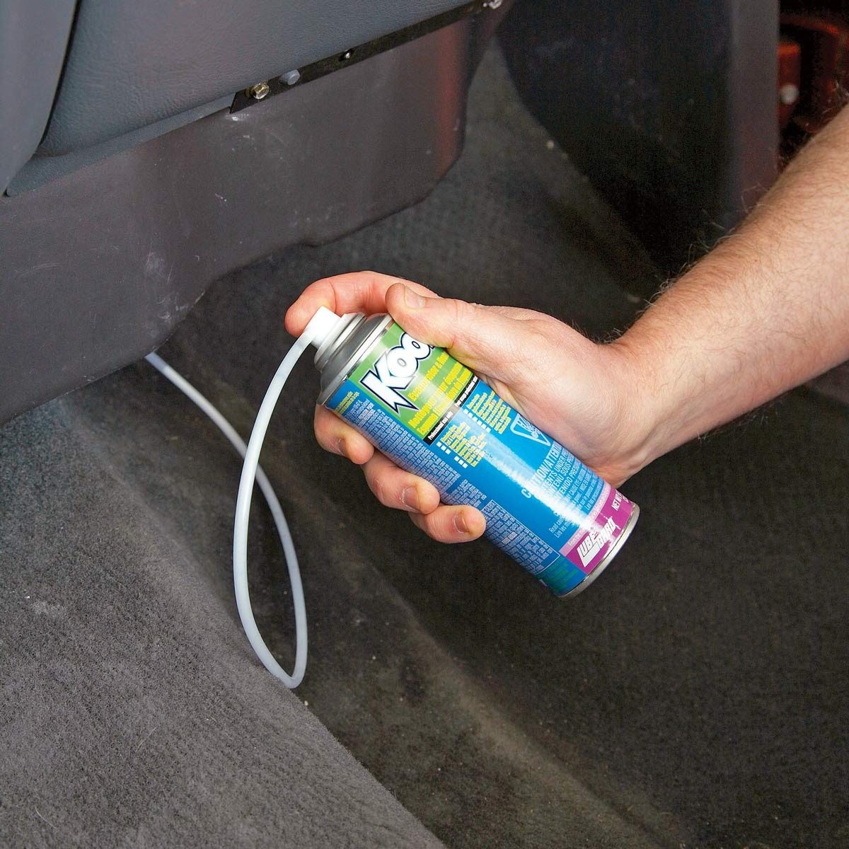 Injecting-mold-killing-foam-into-car-AC