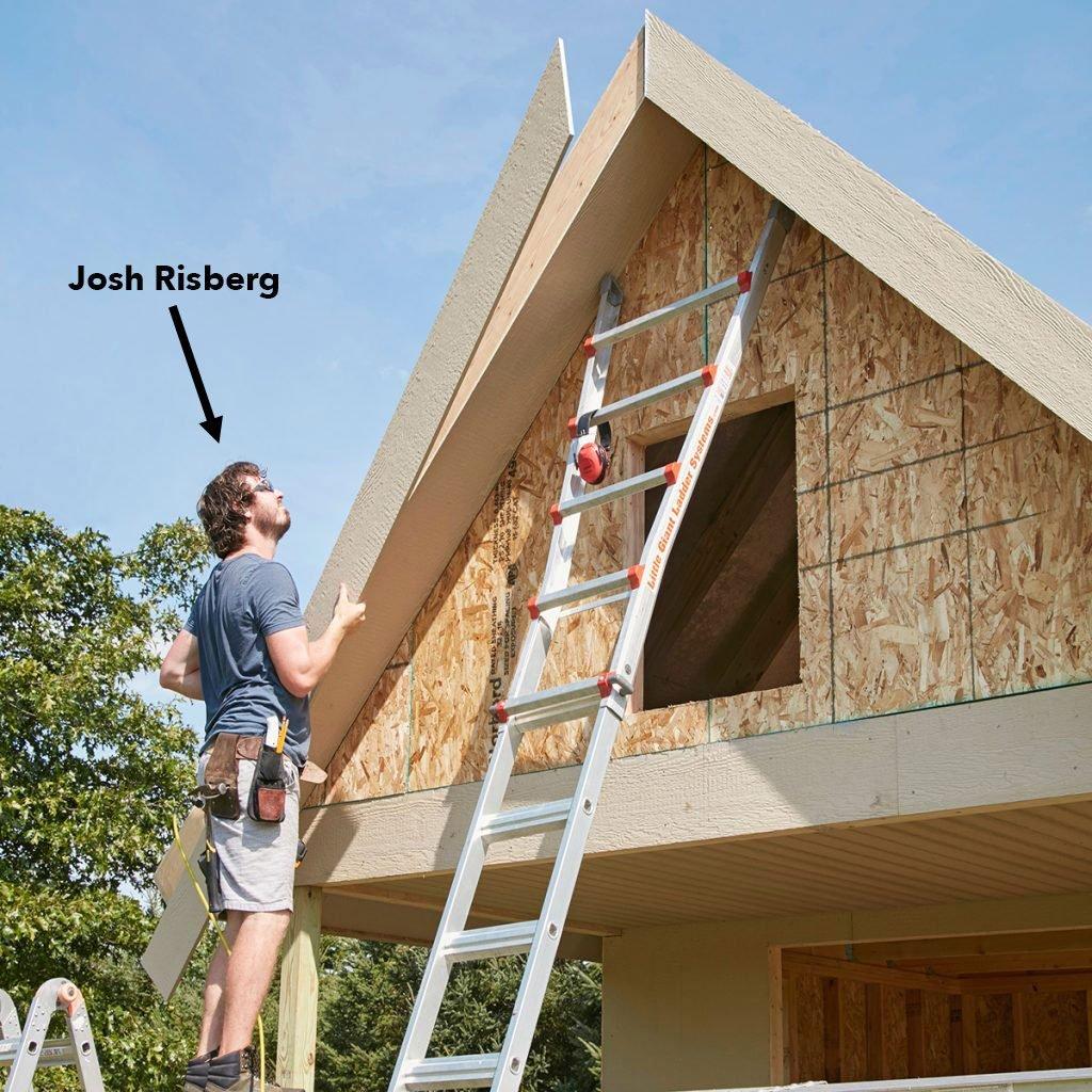 carpenter lining up a long piece of exterior trim