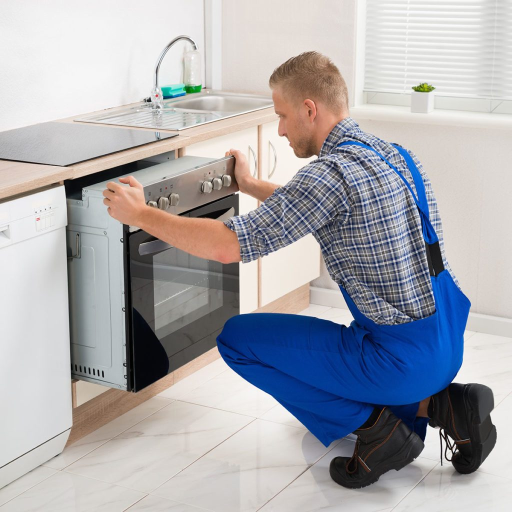 Man installing oven