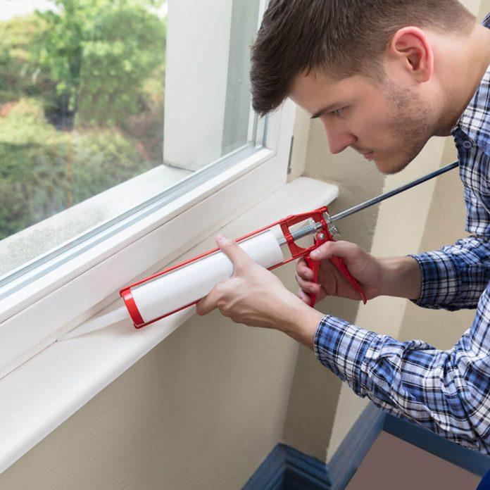 Caulk window shutterstock_686328526 caulk a window to keep your home warm