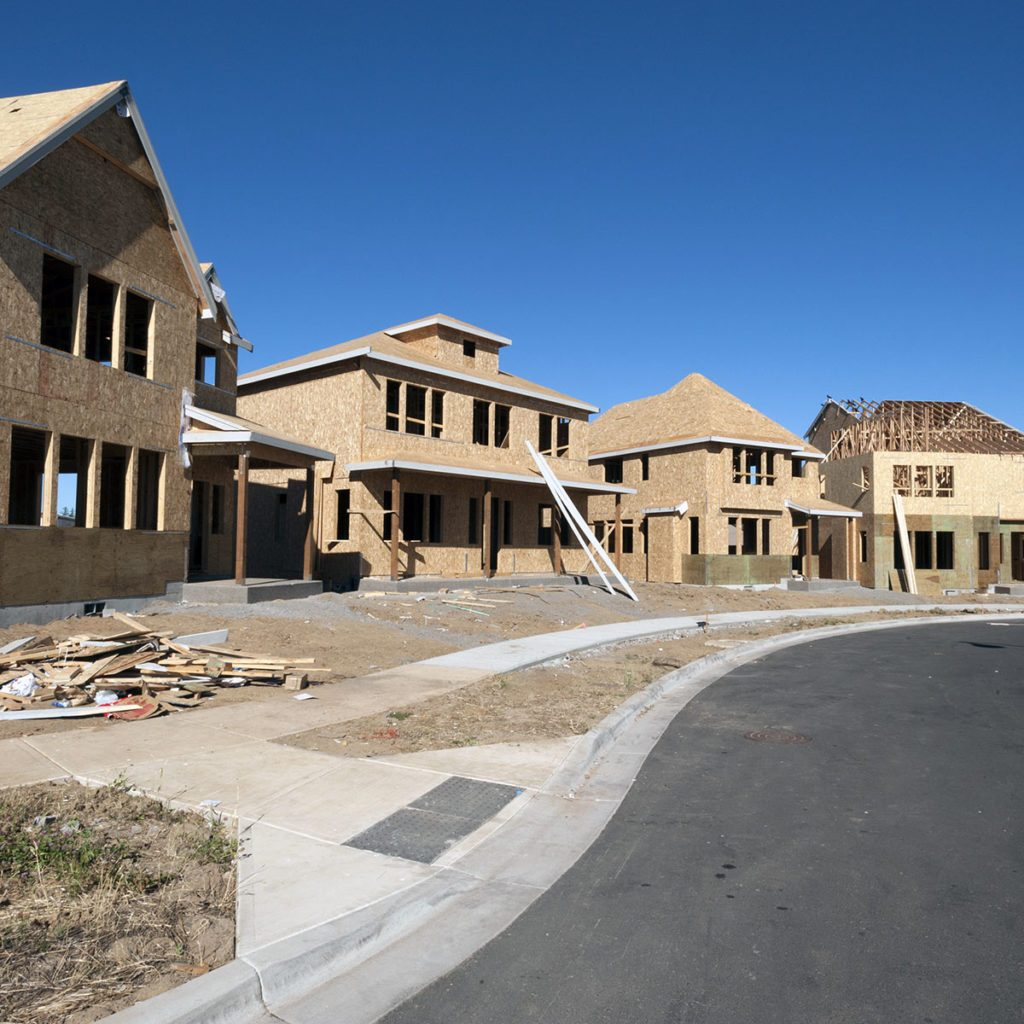 new homes under construction in a development