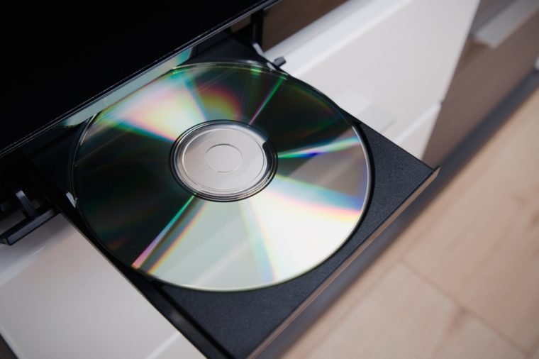 Close up of CD or DVD player with inserted disc