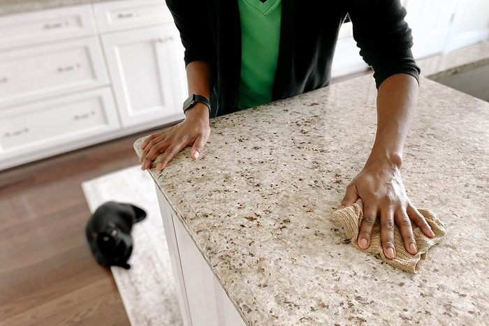 Woman Wipes Kitchen Counter