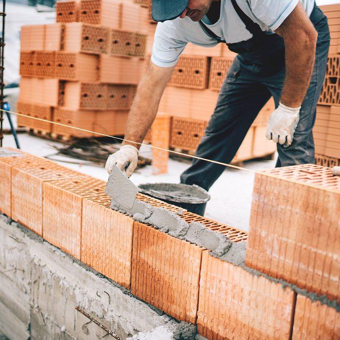 laying brick bricklayer