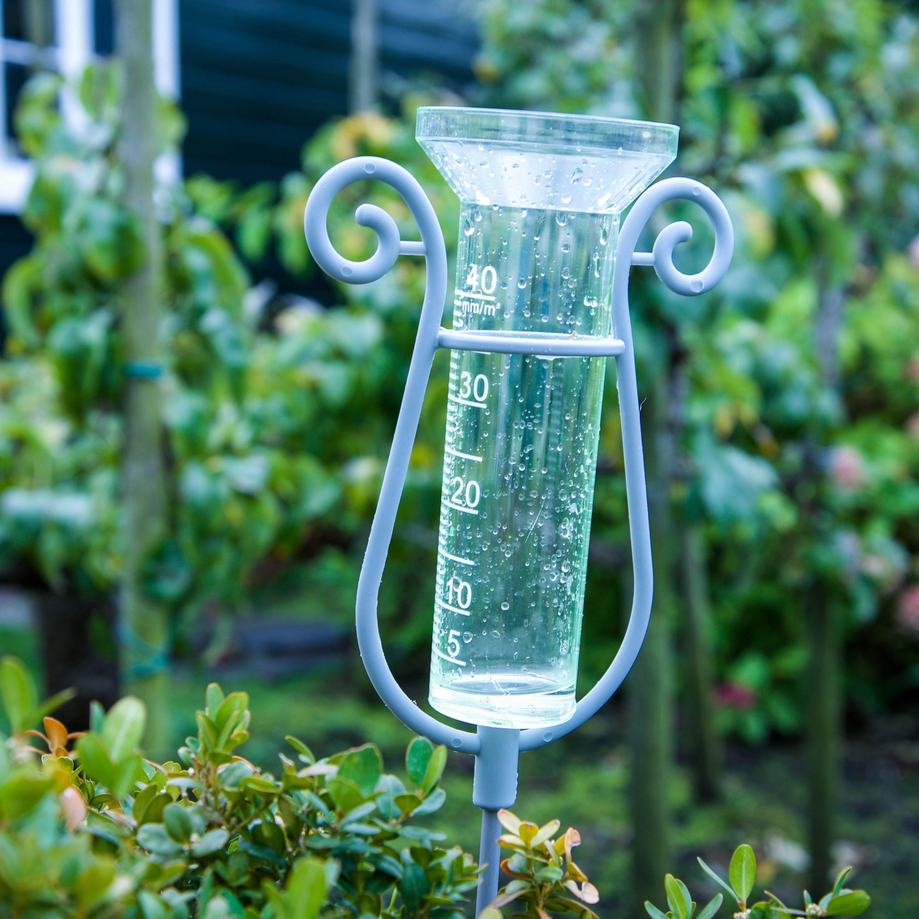 rain gauge in garden; Shutterstock ID 727027459; Job (TFH, TOH, RD, BNB, CWM, CM): TOH Raised Bed Garden