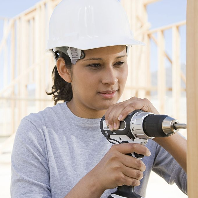 young girl working construction