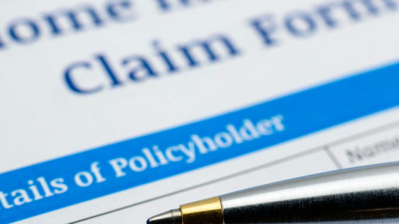 pen on a home insurance claim form