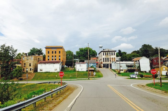 An intersection is seen with a small-town that typifies the rural Midwest beyond.