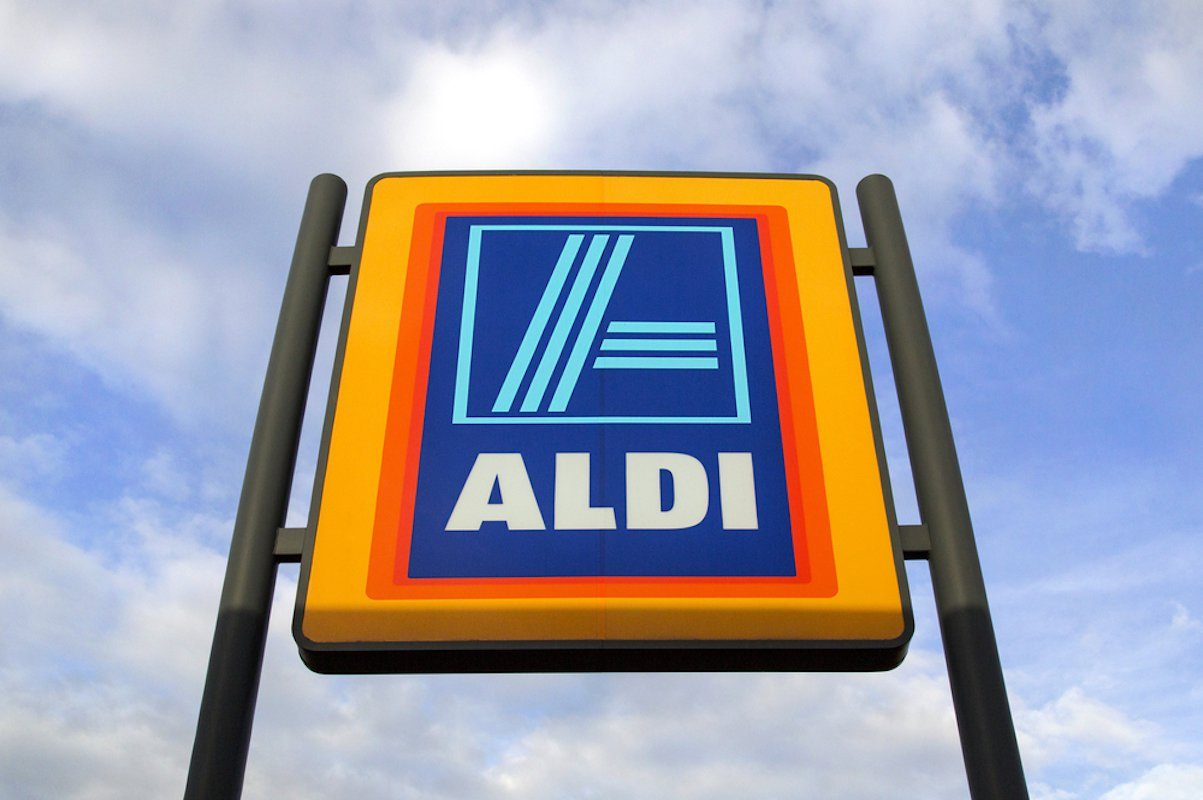 Swansea, UK: May 2016: Commercial sign of ALDI Store against a blue sky. ALDI is a large discount supermarket chain with app. 4200 stores in Germany. It specializes in lower priced products.