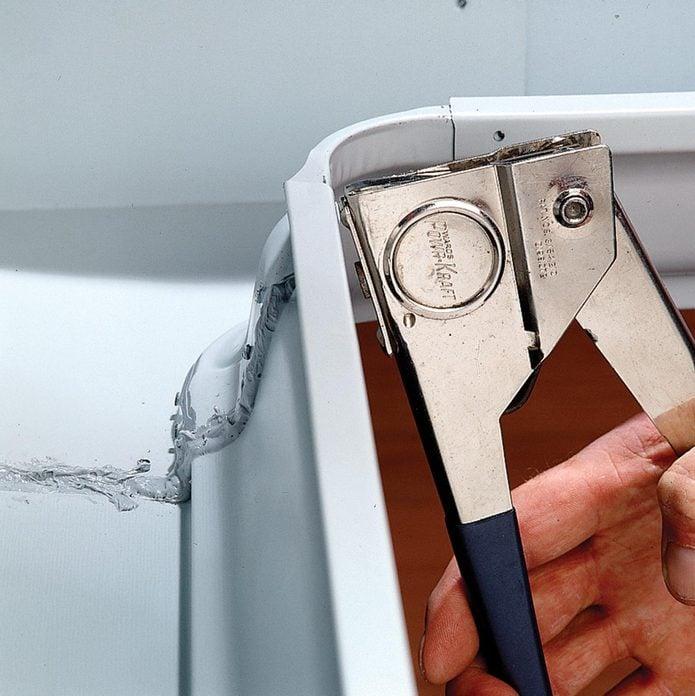 repair leaky metal gutter seams