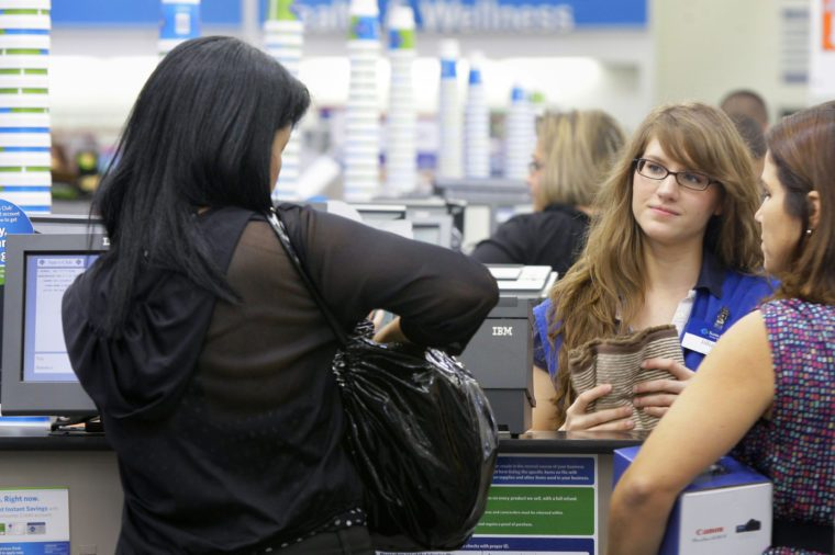 Cashier Jillian Capko, second from right, helps customers at a Sam's Club store in Rogers, Ark