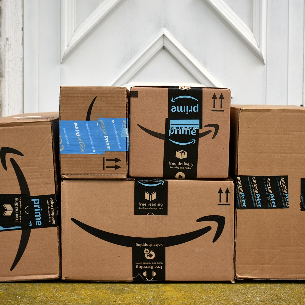 Amazon-boxes-in-front-of-a-white-door