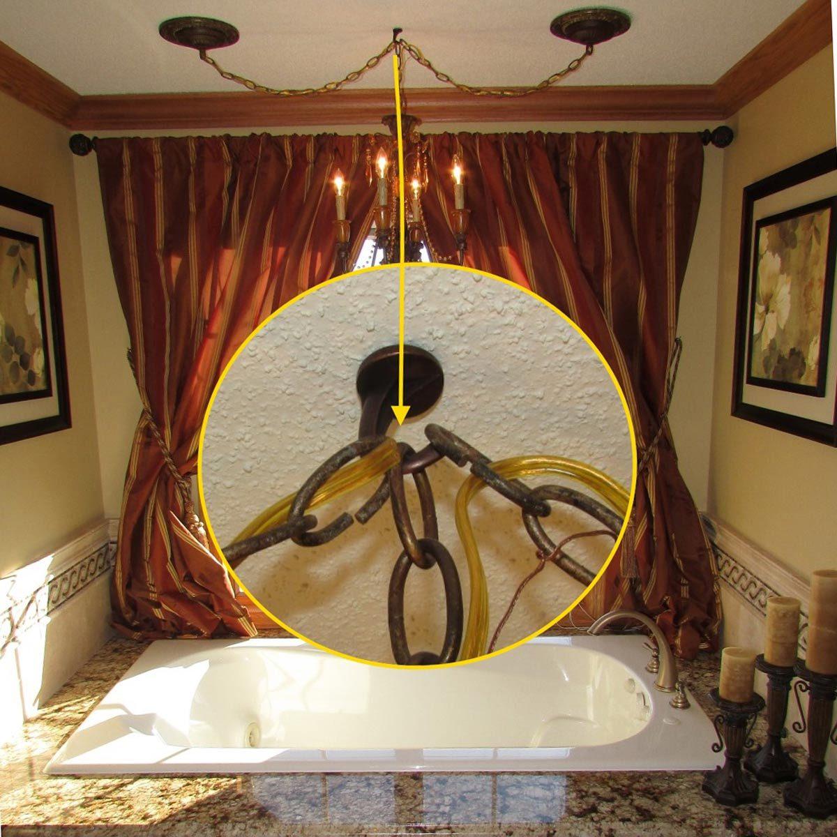 chandelier above bathtub