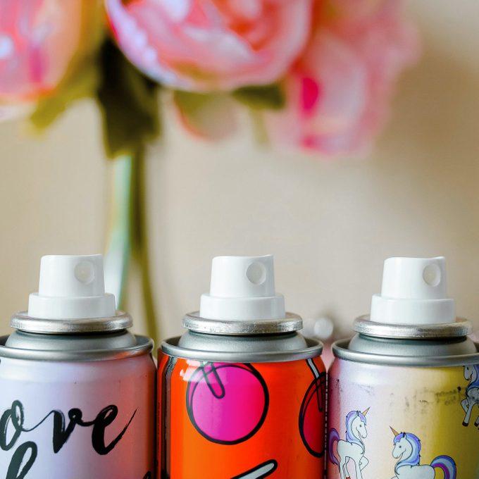 colorful aerosol cans