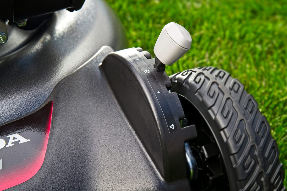 honda mower height adjust