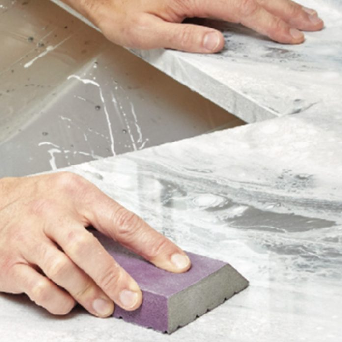 smoothing the top of epoxy countertop