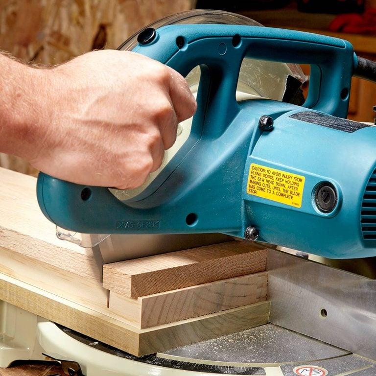 cutting wood on miter saw