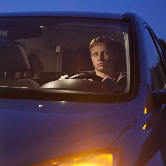 Teenage-boy-driving-a-SUV-at-dusk