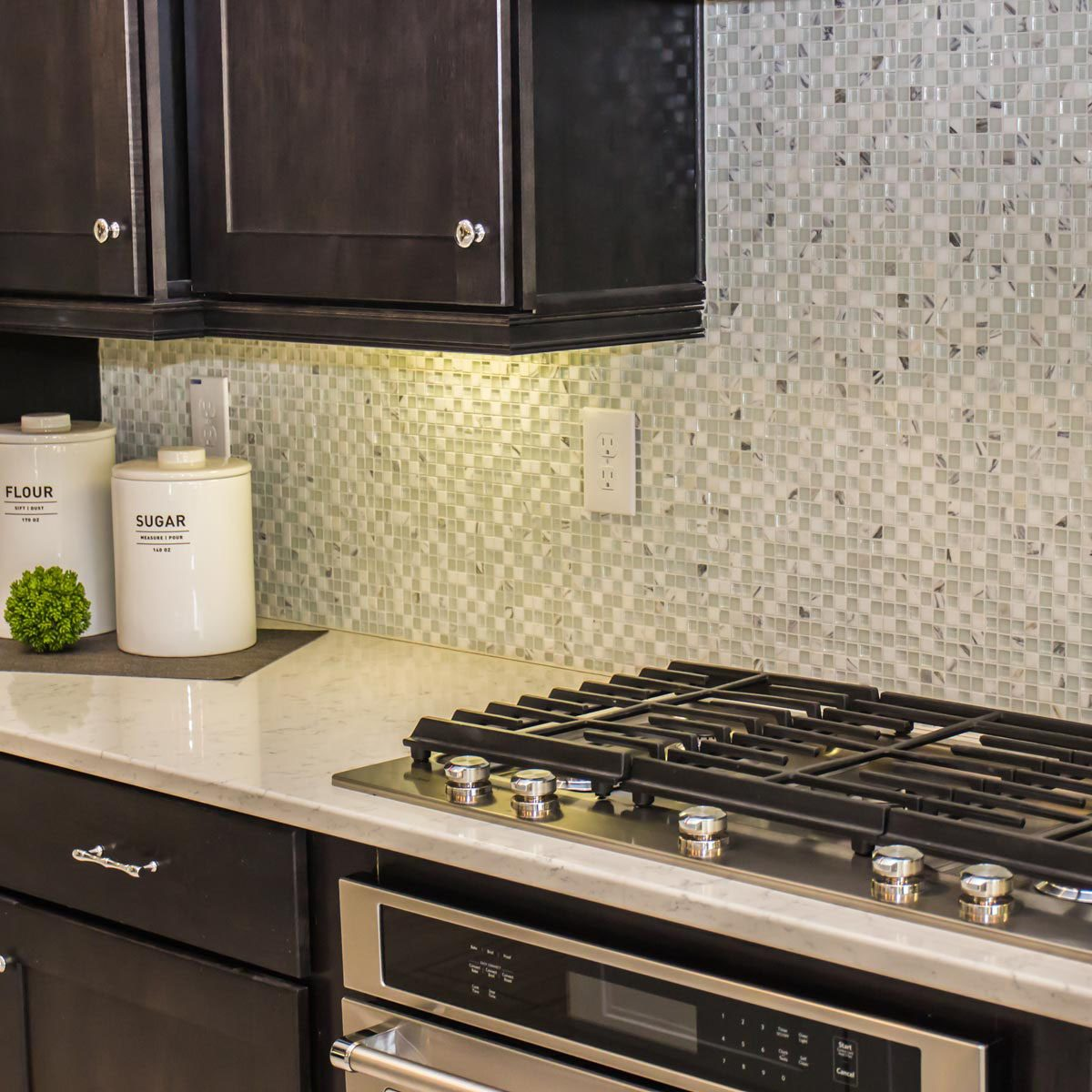 White-mosaic-backsplash-in-kitchen-with-dark-cabinets