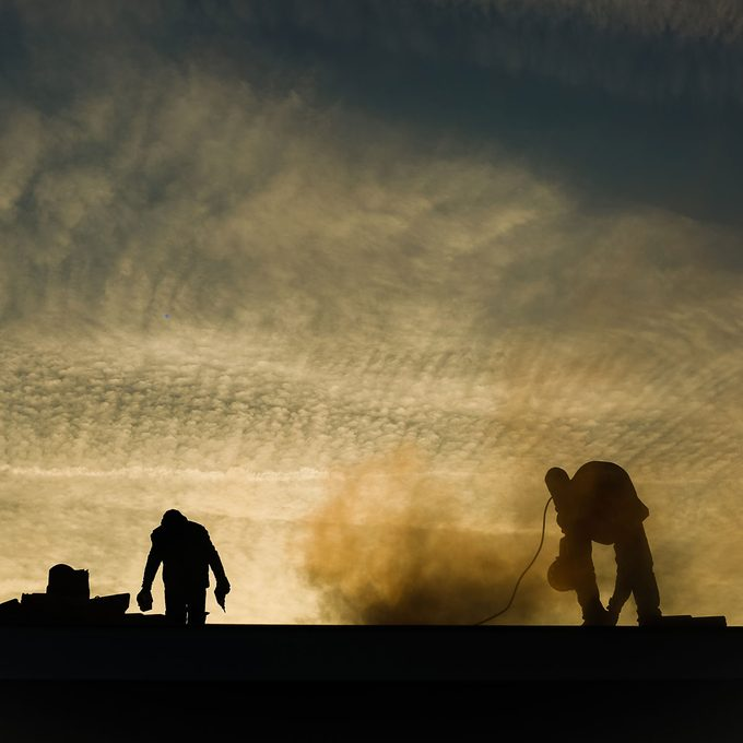 construction workers working on a dusty field (abstract)