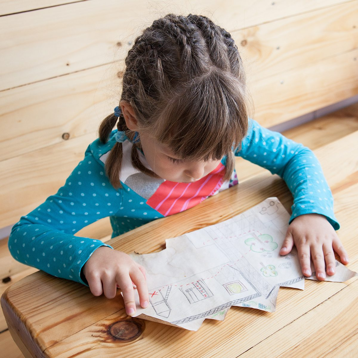 Little girl looking at the treasure map.