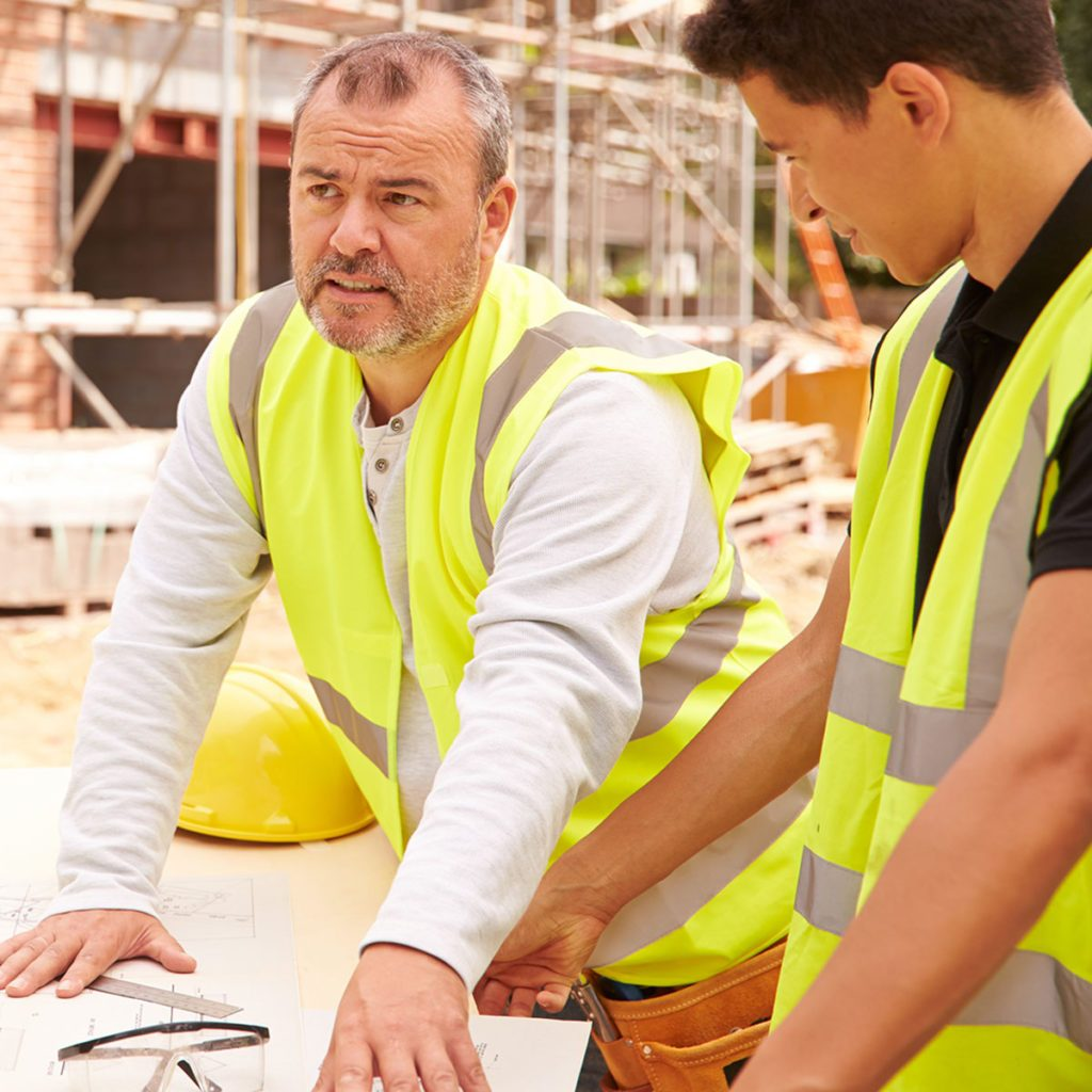 construction professional teaching younger worker