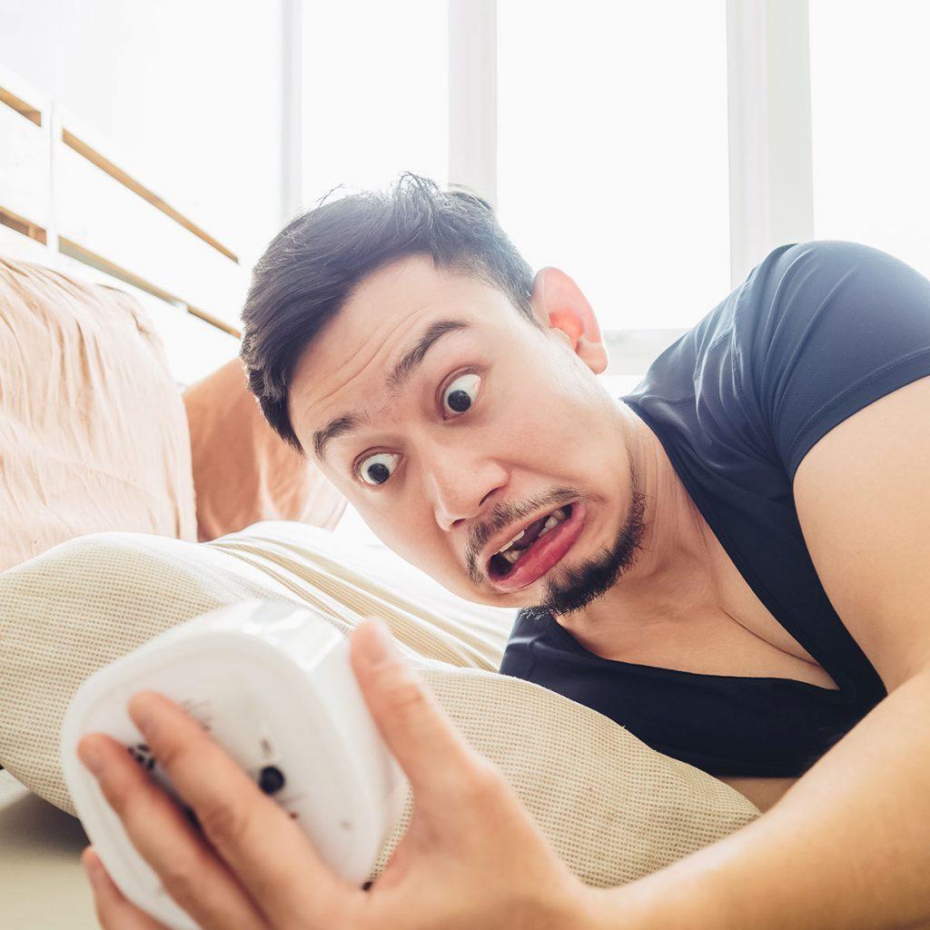 man shocked because he missed his alarm