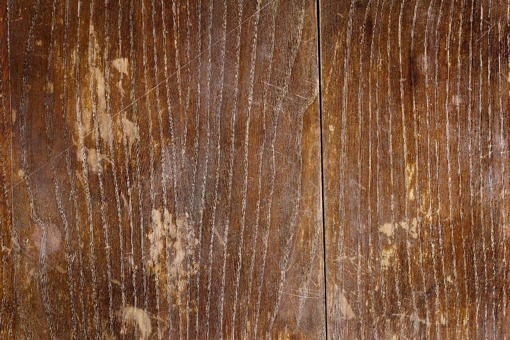 Old scratched oak table top texture background
